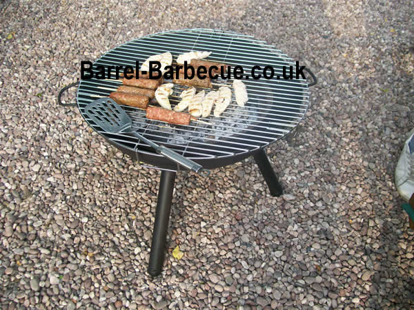 fire pit kettle with burgers